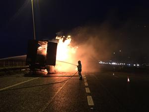 Firefighter tackling a lorry fire on M6