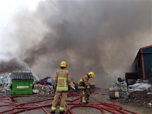 Firefighters tackling a large fire in Ellesmere Port