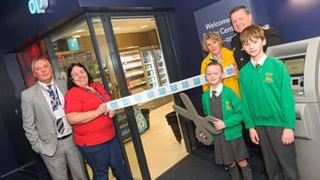 From left, Co-op Format Range and Space Manager Les Old, Safety Central Development Officer Hazel Crampton, Safety Central Volunteer Ranger Steph Plunkett, Cheshire Fire and Rescue Service's Assistant Chief Fire Officer Gus O'Rourke and Kelsie and Thomas from Year 5 at Locking Stumps Community Primary School open the new mock convenience store