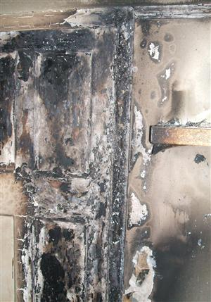 Damage caused to bedroom after candle fire