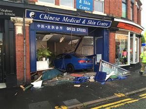 Car collides with building in Warrington
