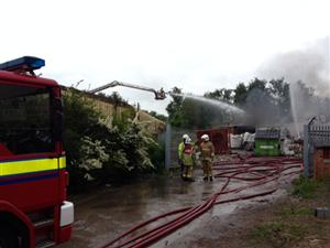Firefighters at the scene of a large fire in Ellesmere Port