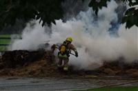 Firefighter tackling a lorry fire