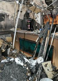 Photo showing the fire damage to a business premises