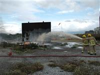 Firefighters extinguishing fire in training exercise
