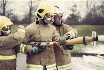 Firefighters training to use a hose reel jet