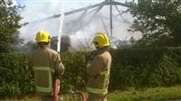 Firefighters tackling a barn fire in Tattenhall