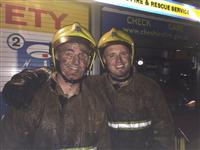 Firefighters after tackling a fire involving a pile of coal