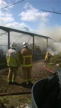 Firefighters at the scene of a barn fire in Tattenhall