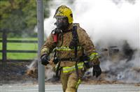 Firefighter at the scene of a hay lorry fire