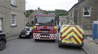 Fire engine struggles to get past parked cars