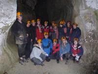 Team photo inside a cave