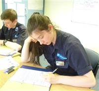Cheshire fire cadets completing some written work whilst at the fire station