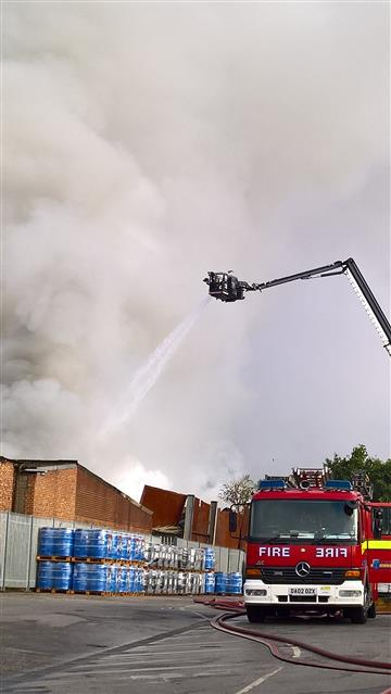 Aerial appliance tackling a fire in Widnes