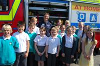 Firefighter Clare Page and children in front of fire engine