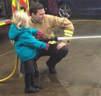 A Hero in the Community on a hose reel jet