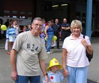 Grandparents with a child at a fire station open day in Warrington