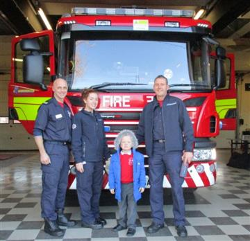 Four-year-old Alfie Burke with White Watch firefighters at Ellesmere Port Fire Station