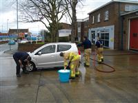 Firefighters from Ellesmere Port washing cars at the 11th annual national Fire Fighters Charity car wash