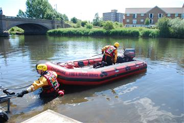Fire and Rescue boat being launched onto the river