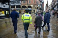 Residents walking through Chester city centre