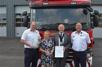 Left to right - Phillip Byrne station manager at Merseyside Fire and Rescue Service, Susan Spence healthcare professional facilitator at Cancer Research UK, Cllr Bob Rudd Chair of the Cheshire Fire Authority and Ant Fletcher Watch Manager at Powey Lane Fire Station