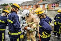 Cheshire fire cadets anda firefighters take part in a road traffic collision demonstration