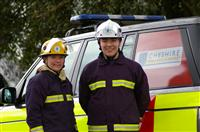 Cheshire fire cadets stood by the side of a fire engine