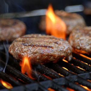 Burgers being cooked on a barbecue