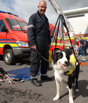 Search dog Bryn with his handler, firefighter steve buckley