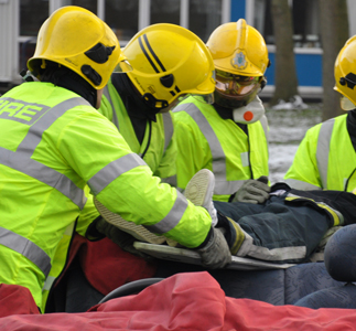 Firefighters with a casualty on a stretcher during an exercise