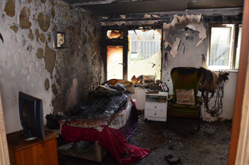 Taken at the event, this picture shows the impact a fire can have on a room without a sprinkler system after only four minutes.