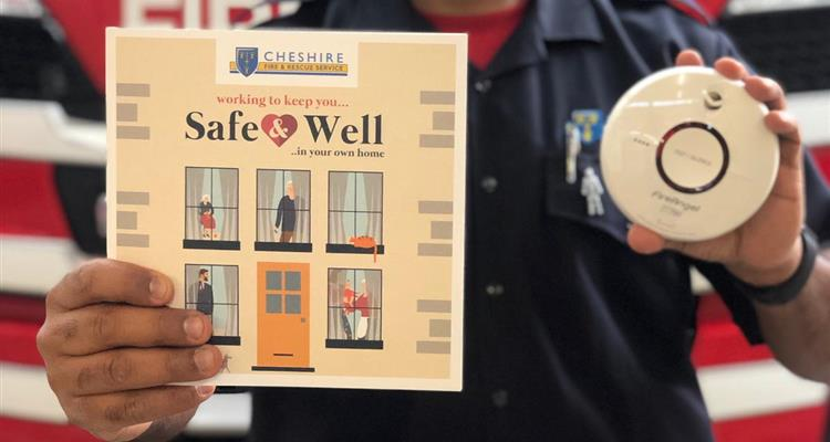 Firefighter with smoke alarm and safe and well booklet