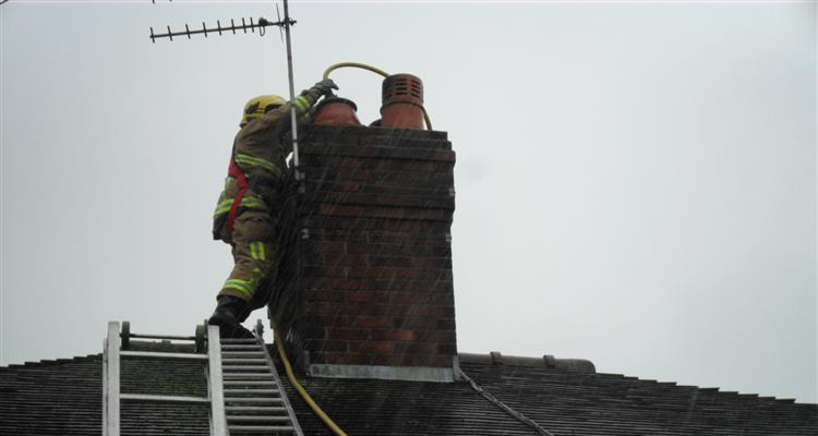 Congleton firefighter tackles chimney fire from roof